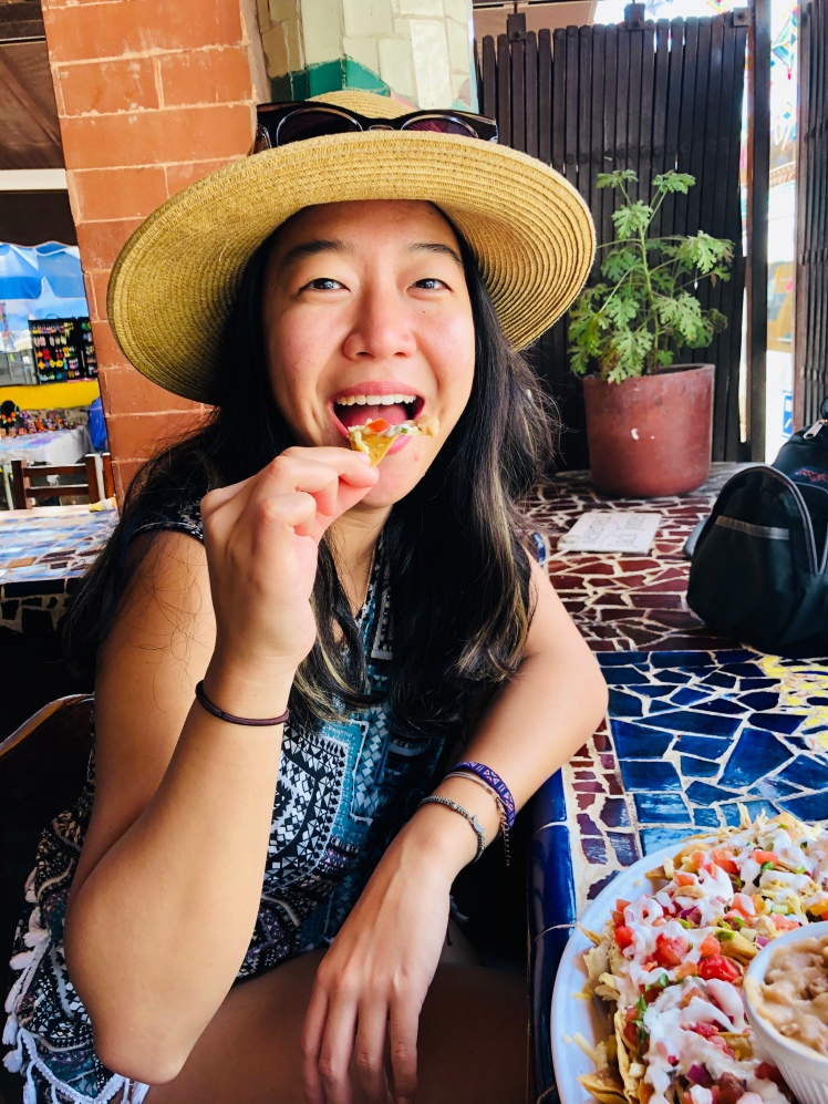 Girl eating nachos