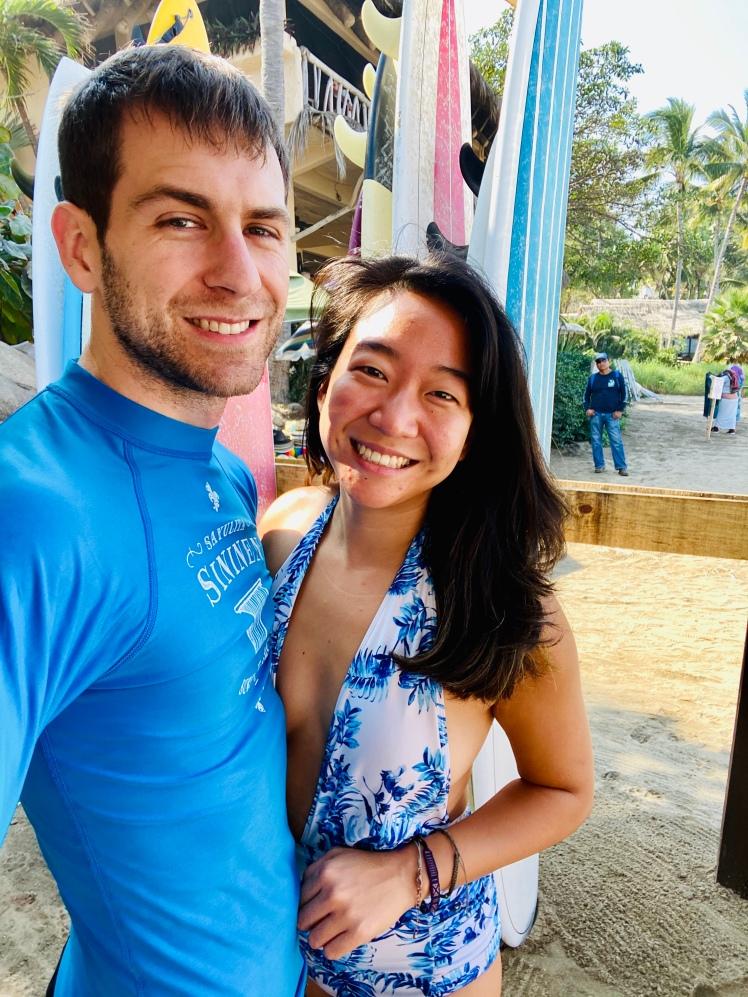 Interracial couple surfing