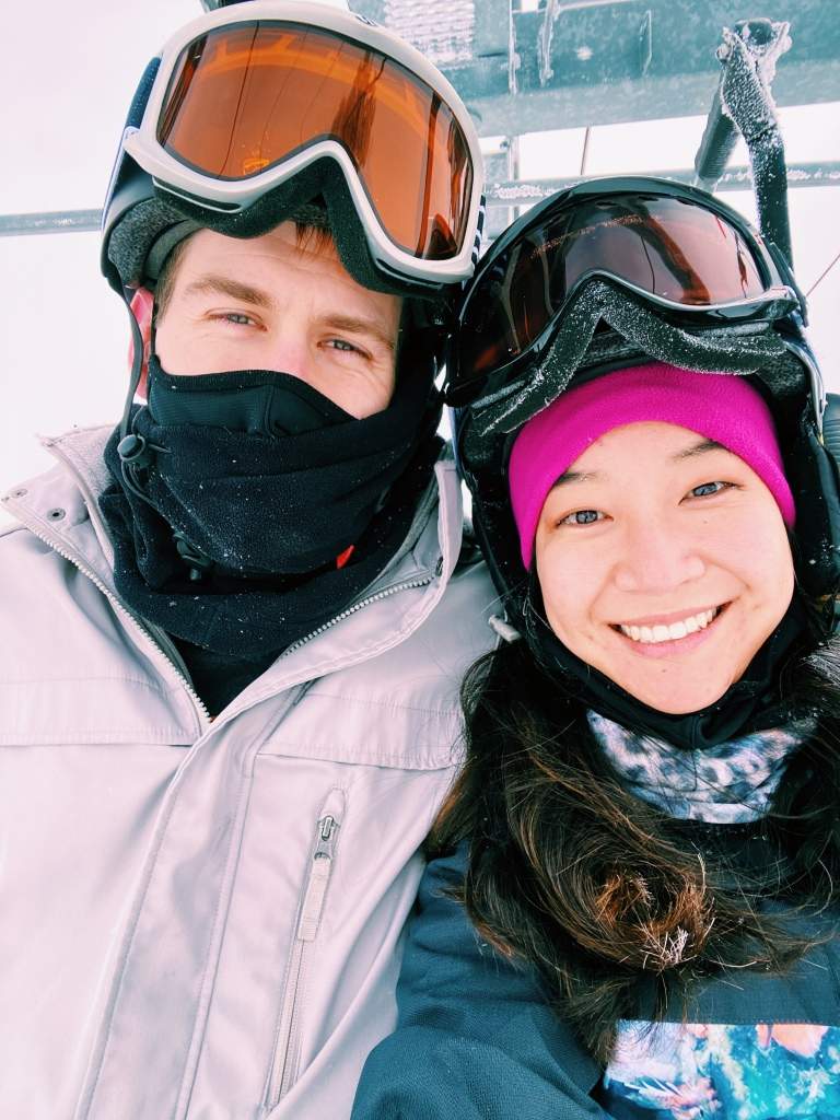 Active couple going skiing