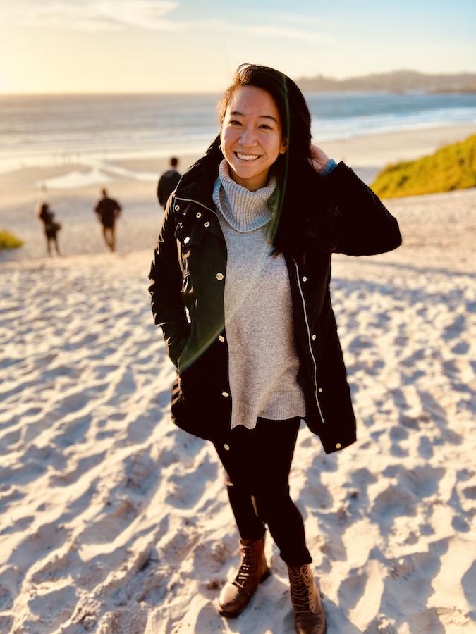 Girl posing on Carmel beach at sunset