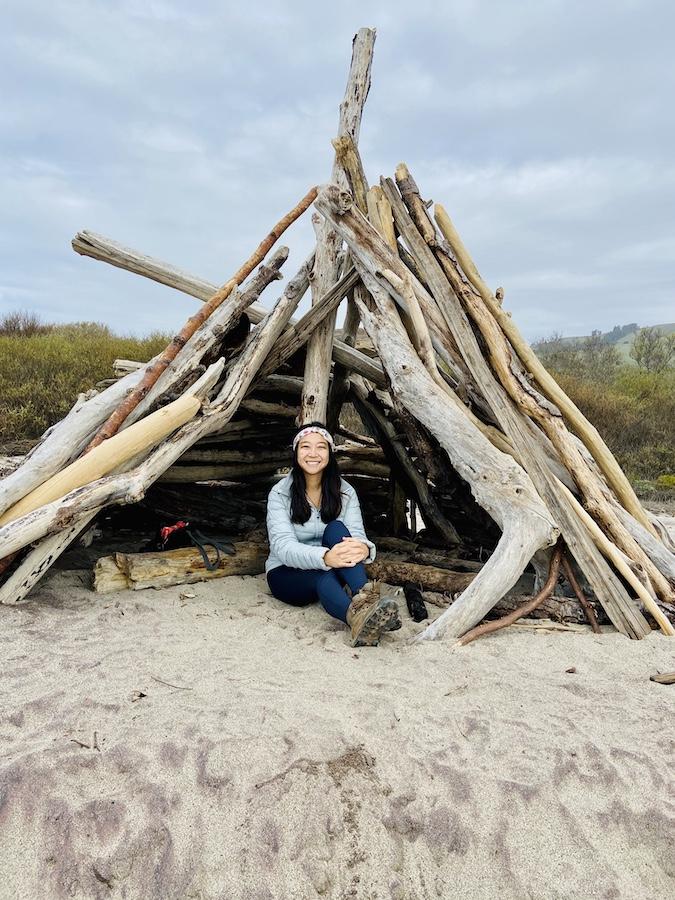Wooden teepee on beach