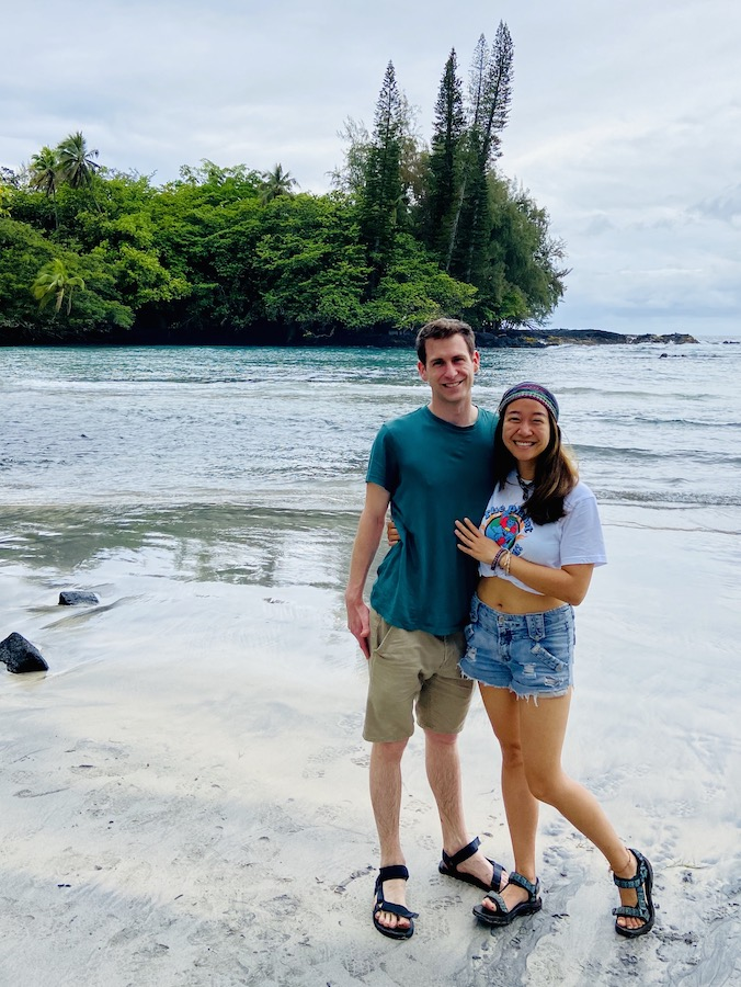 Couple on beach after long hike