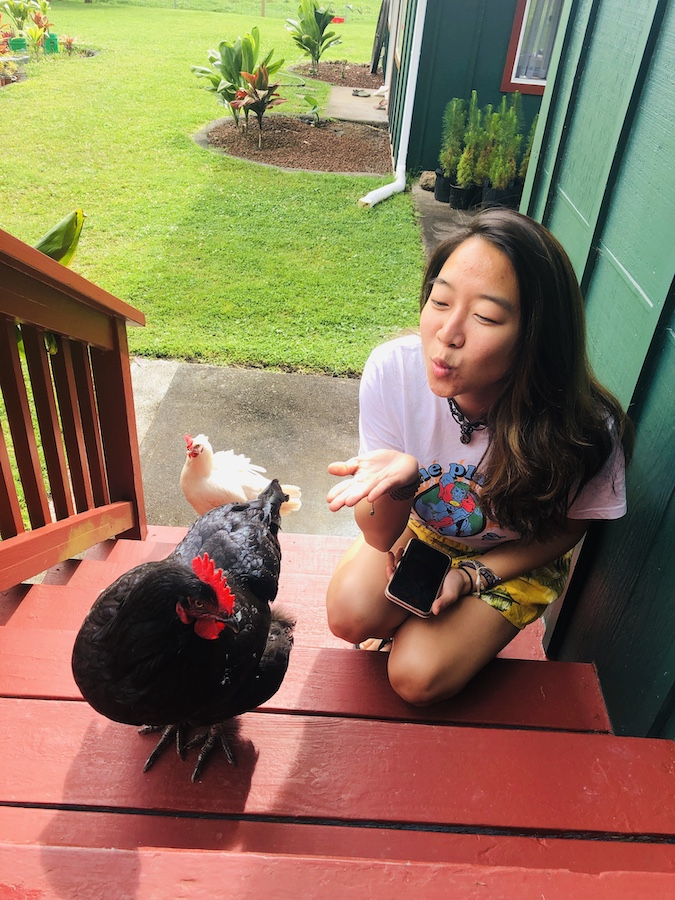 Blowing kisses to chickens