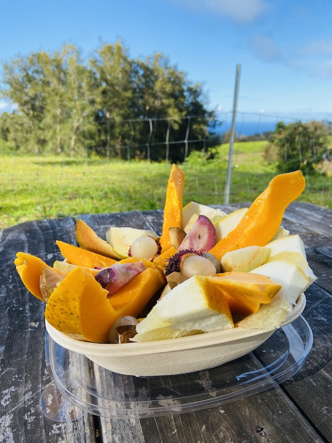 Exotic fruit bowl in fruit stand in Waimea