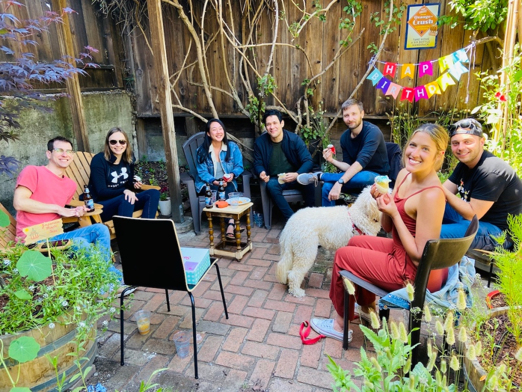 Guests at outdoor garden party for birthday