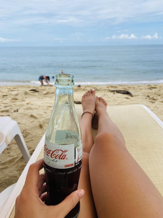 Drinking diet coke on San Pancho beach