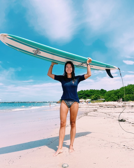 Holding surf board on head