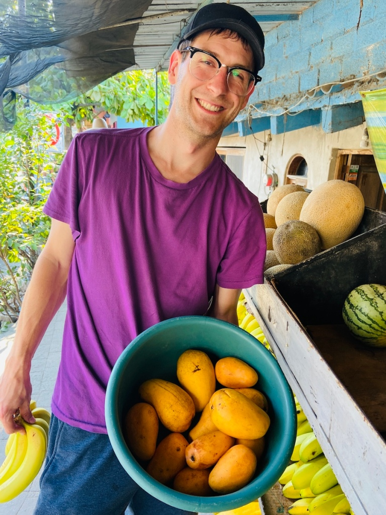 Buying mangos at a local produce stand in Mexico